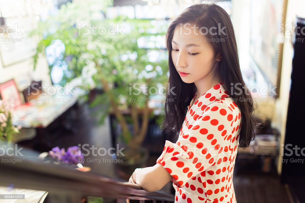 girl standing in the attic stock photo
