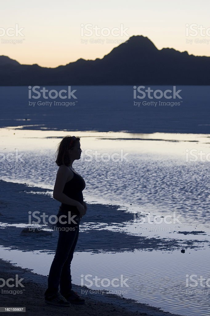 Girl Standing in Water Silhouette stock photo