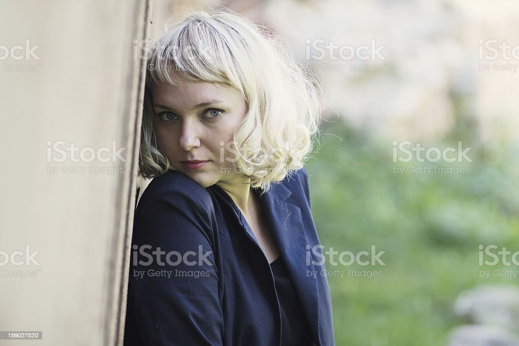 girl standing near the wall royalty-free stock photo