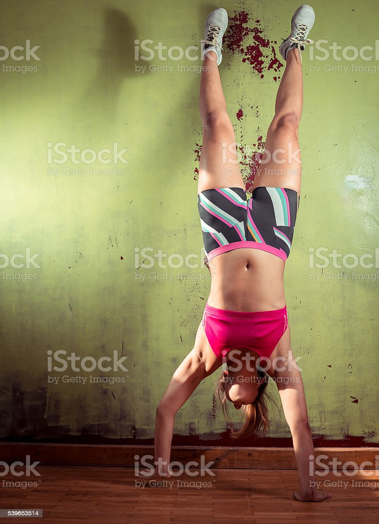 Girl standing on hands stock photo