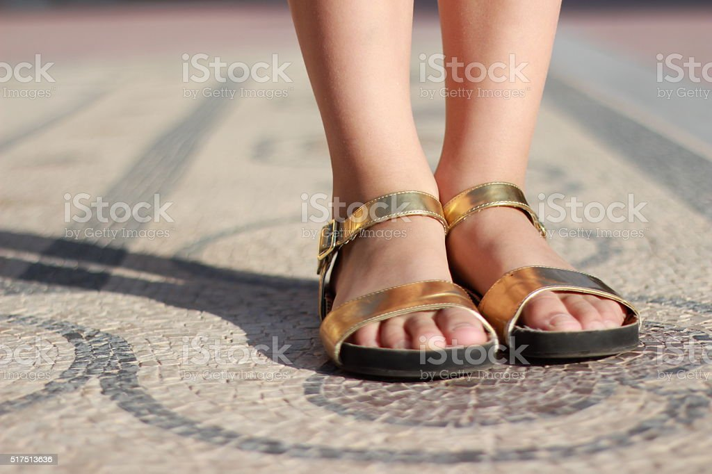 Girl standing on pebble mosaic decorated floor stock photo