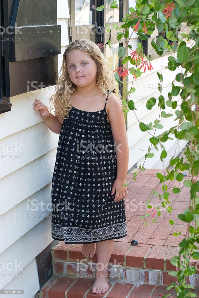 Girl standing on porch royalty-free stock photo