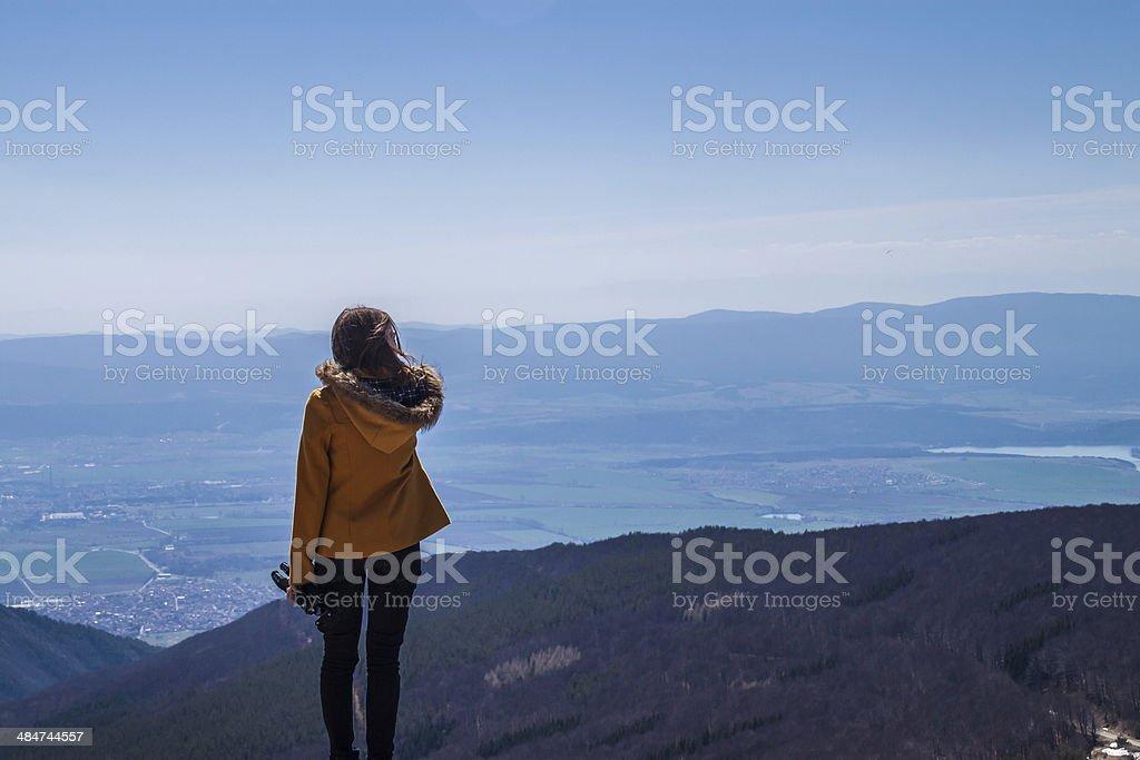 Girl standing on the edge stock photo