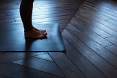 Girl standing on the mat, stretching toes
