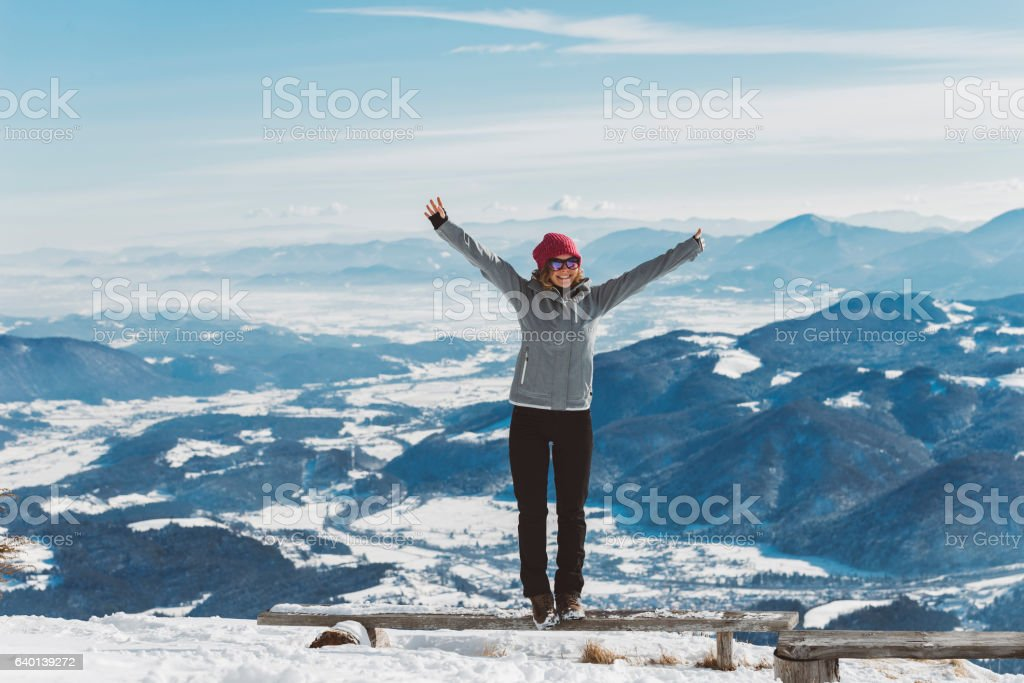 Girl standing on the top of the mountain stock photo