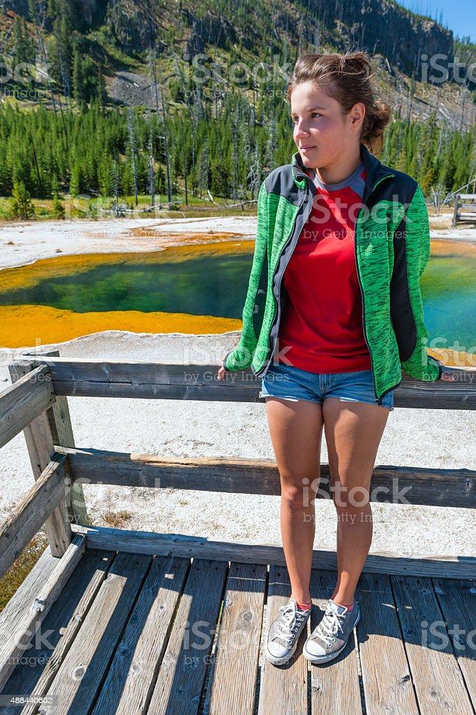 Girl, standing, watching Green Spring  Lake in Yellowstone Wyoming USA stock photo