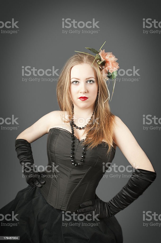Girl standing with a flower on  head royalty-free stock photo