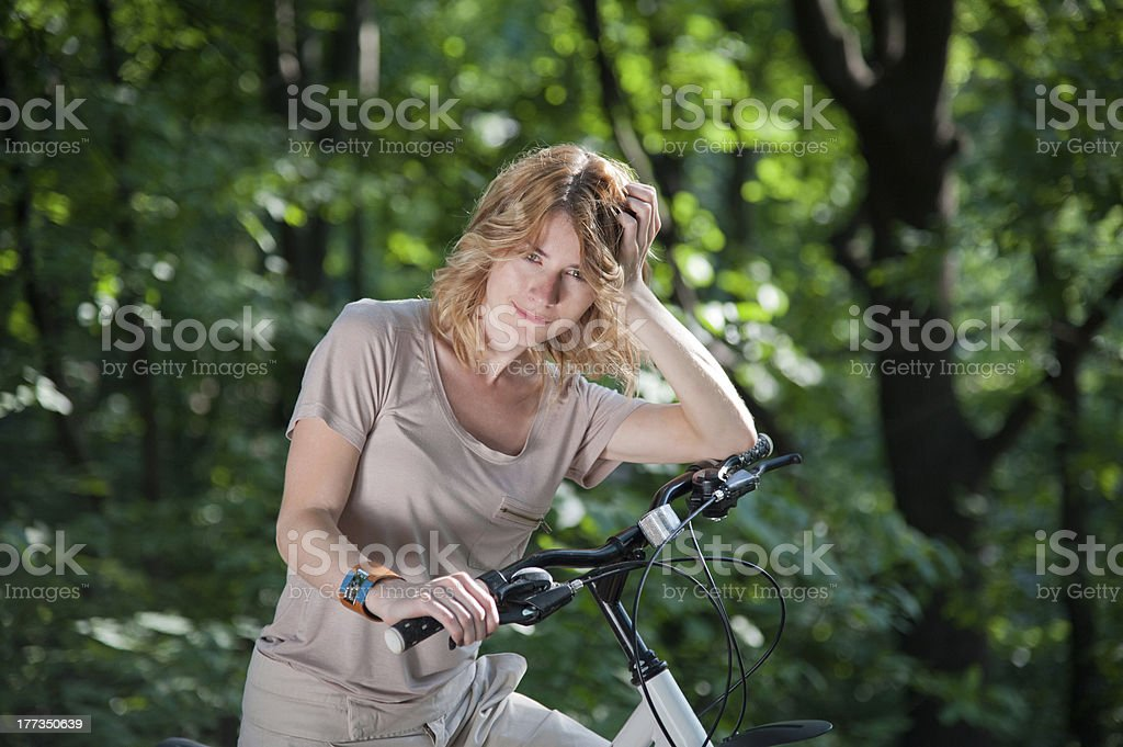 Girl stay with a bicycle royalty-free stock photo