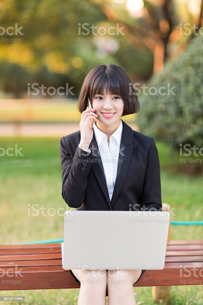 girl sting in the park office stock photo