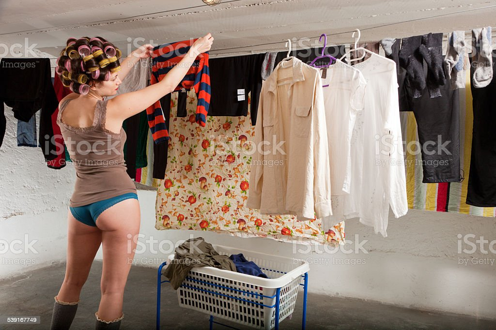 girl stretches clothes in the room stock photo