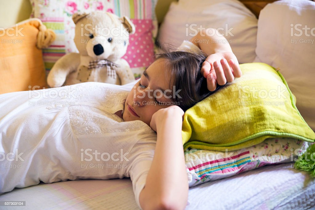 Girl stretching in bed after wake up, Healthy lifestyle stock photo