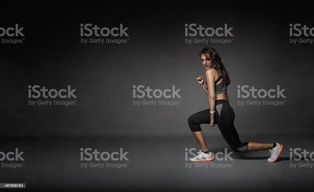 girl stretching legs stock photo