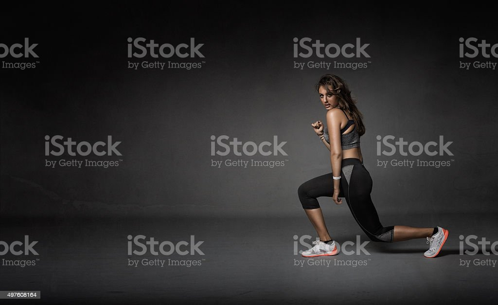 girl stretching legs stock photo