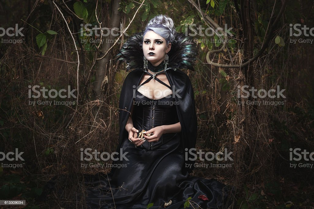 Girl strikes fear in the forest. stock photo