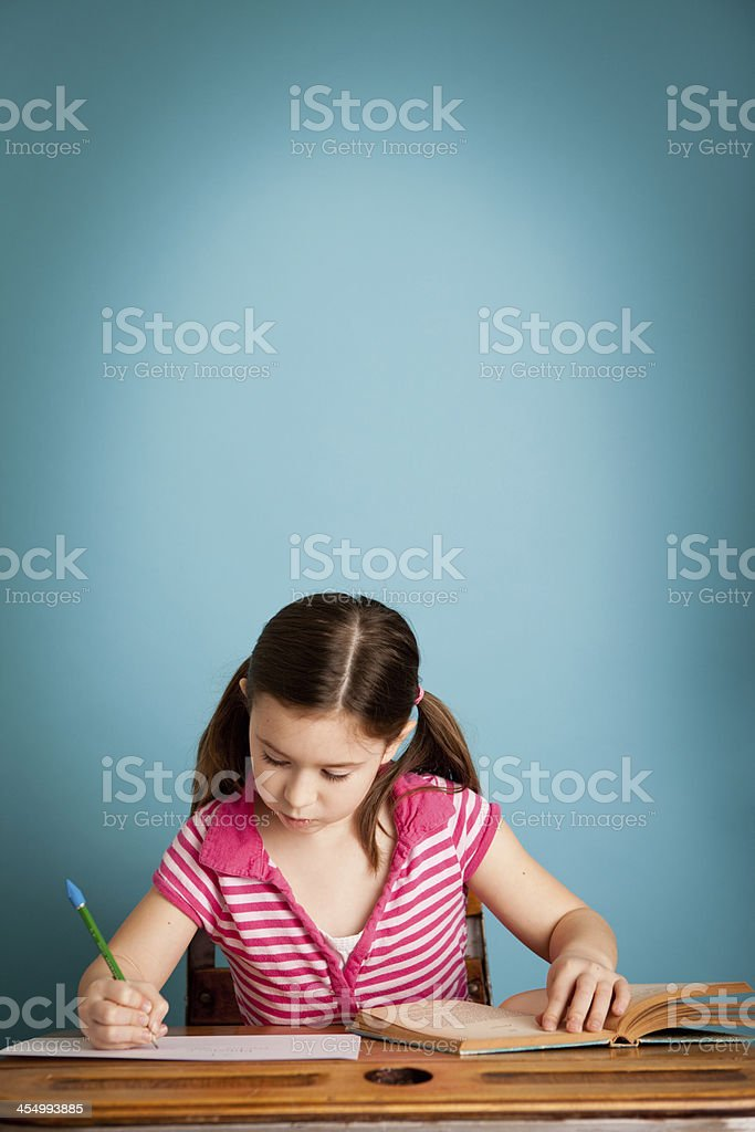 Girl Student Doing Her Homework, with Copy Space royalty-free stock photo