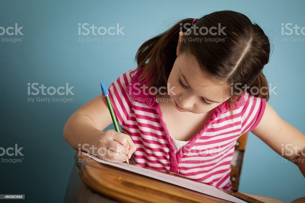 Girl Student Doing Work at School Desk royalty-free stock photo