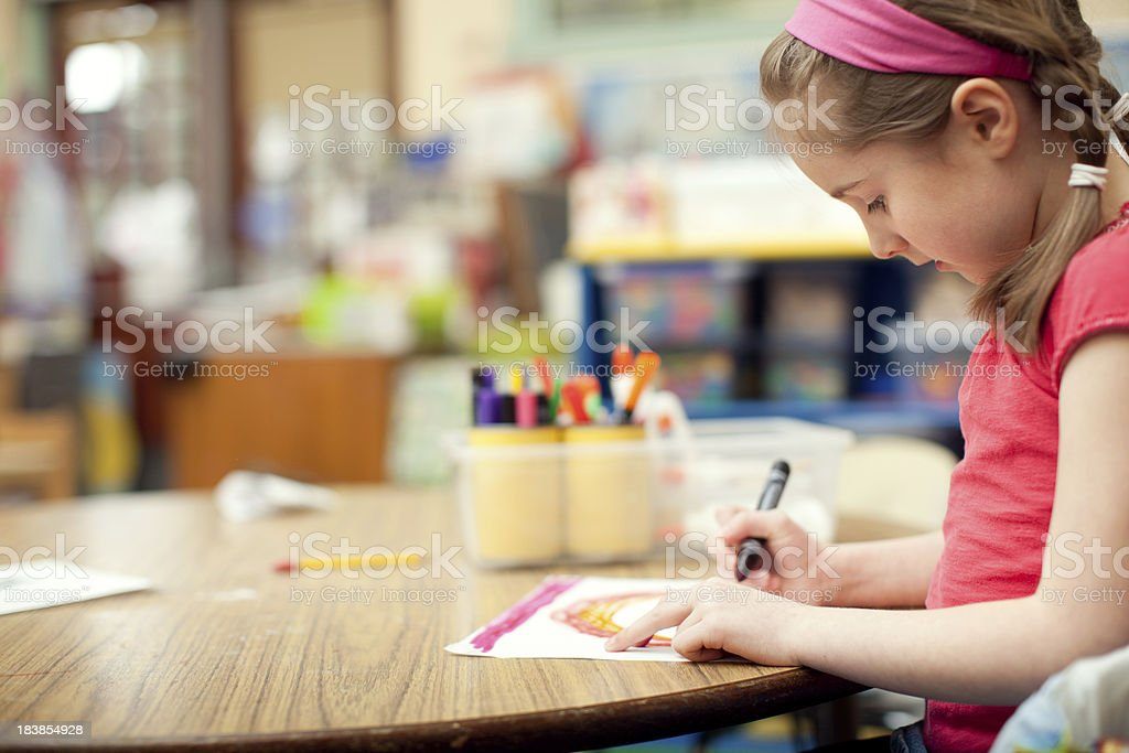 Girl Student Drawing a Picture at School royalty-free stock photo