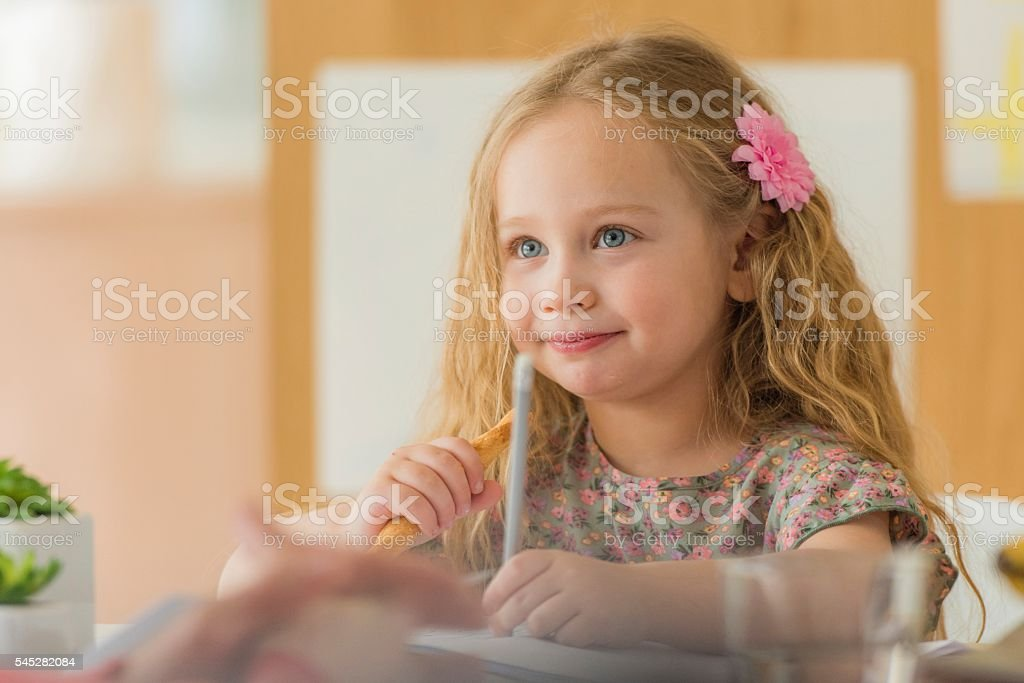 Girl studying at home stock photo
