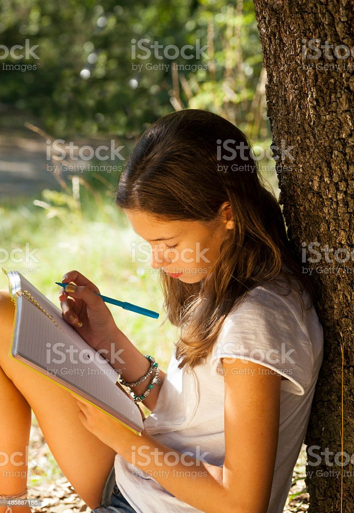Girl studying outdoors stock photo