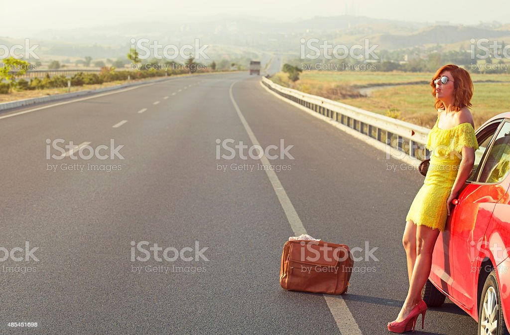 Girl, Stukced on the Highway stock photo