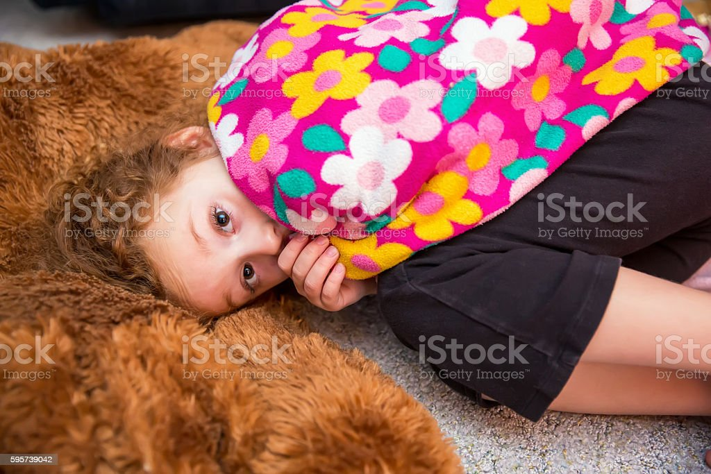 Girl Sucking Thumb With Pink Security Blanket stock photo