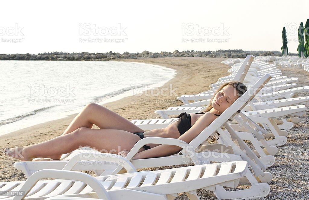 Girl suntanning. royalty-free stock photo
