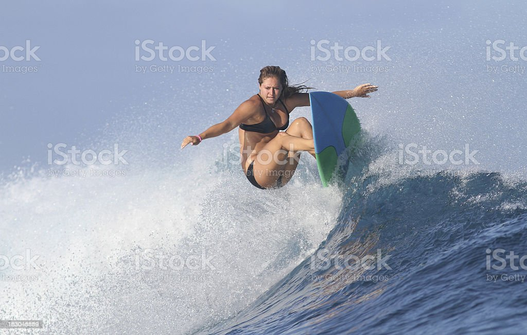 girl surfing a wave stock photo