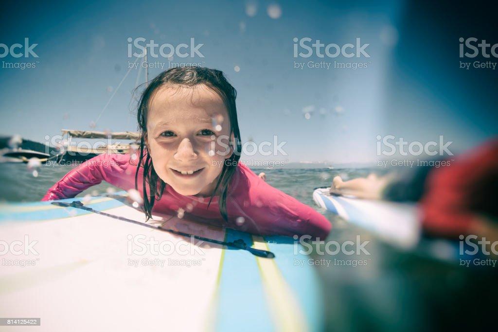 girl surfing stock photo