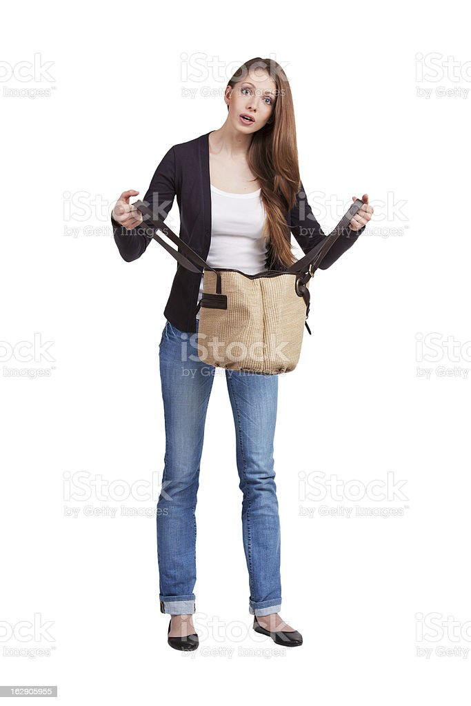 Girl surprised by what she saw in her purse royalty-free stock photo