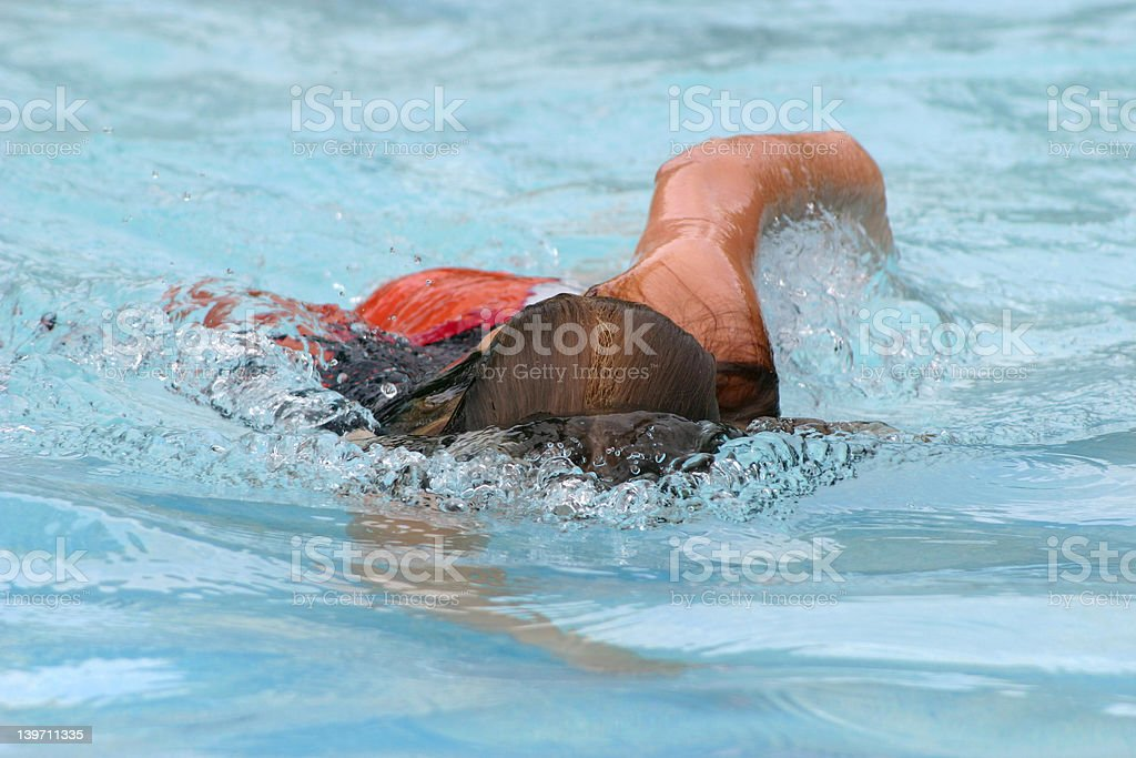 Girl swimming stock photo