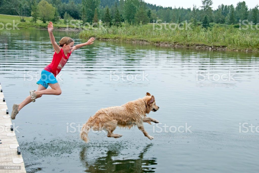 Girl Swimming With Her Dog stock photo