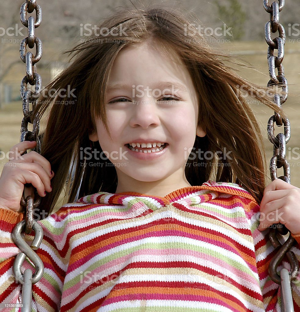 Girl Swinging at the Park stock photo