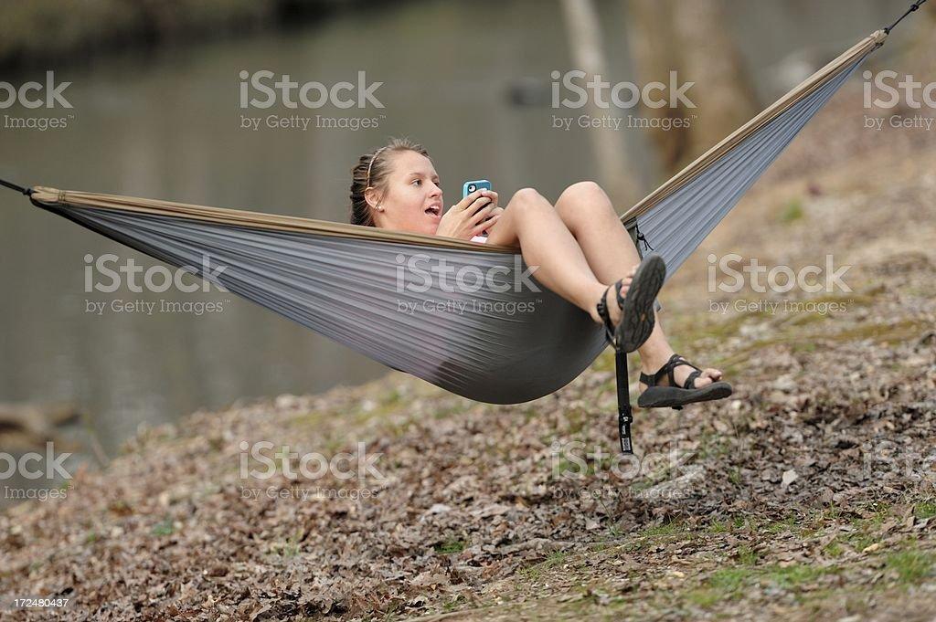 Girl swinging in hammock singing royalty-free stock photo