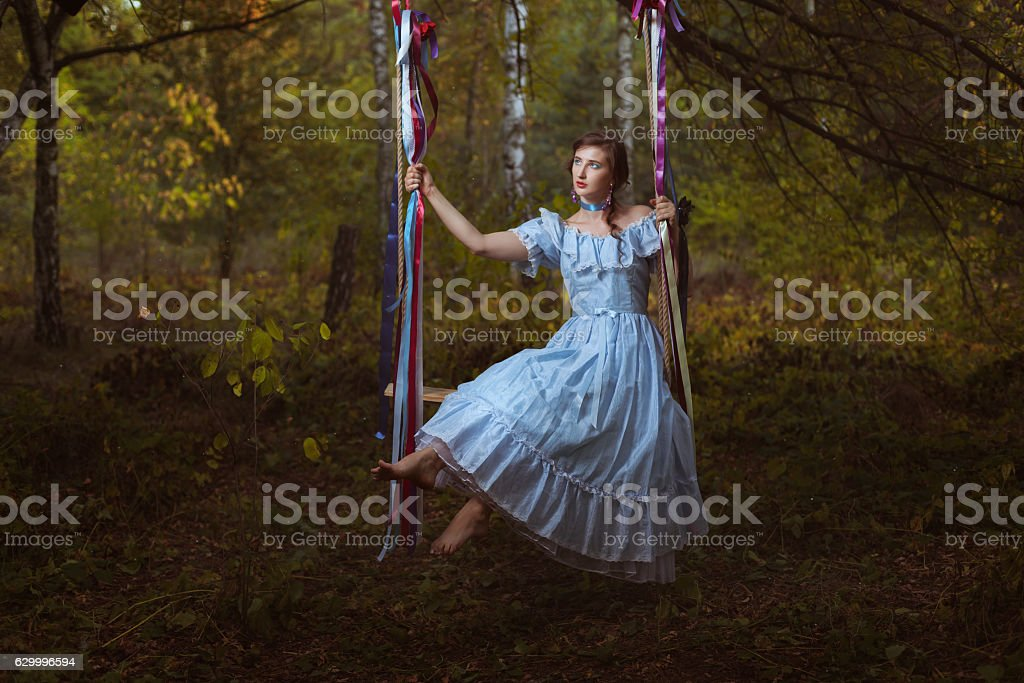 Girl swinging on a swing. stock photo