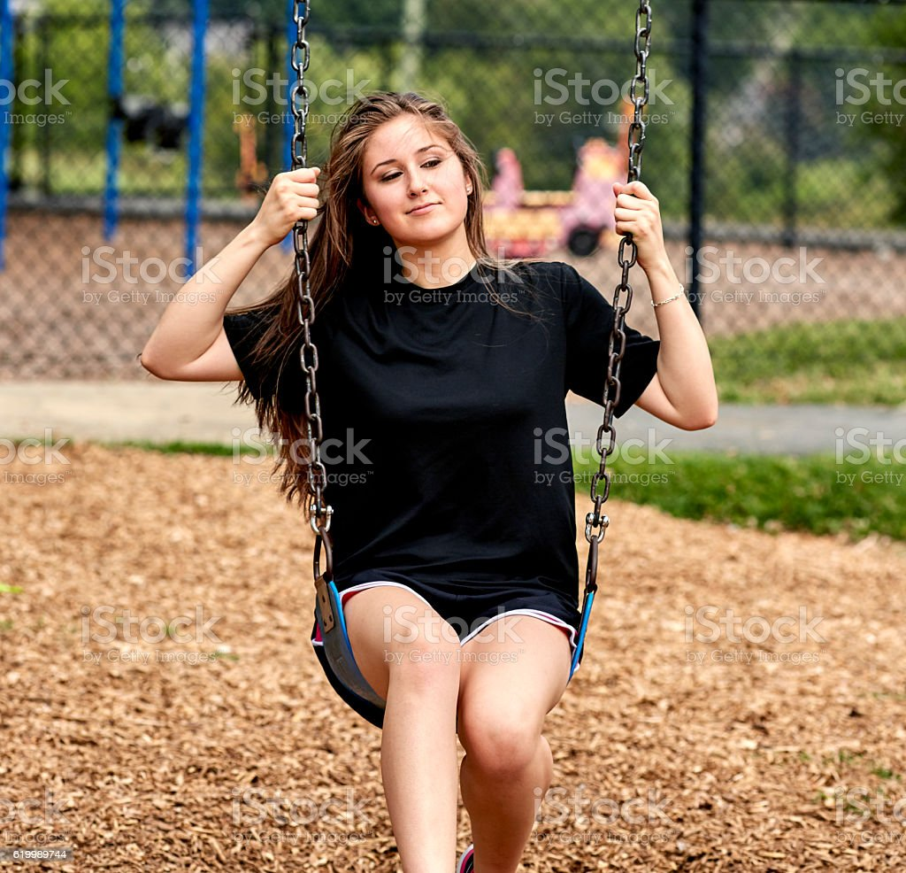 Girl swinging on Swing stock photo
