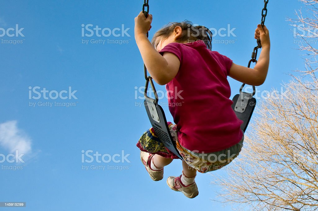 girl swings into sky royalty-free stock photo