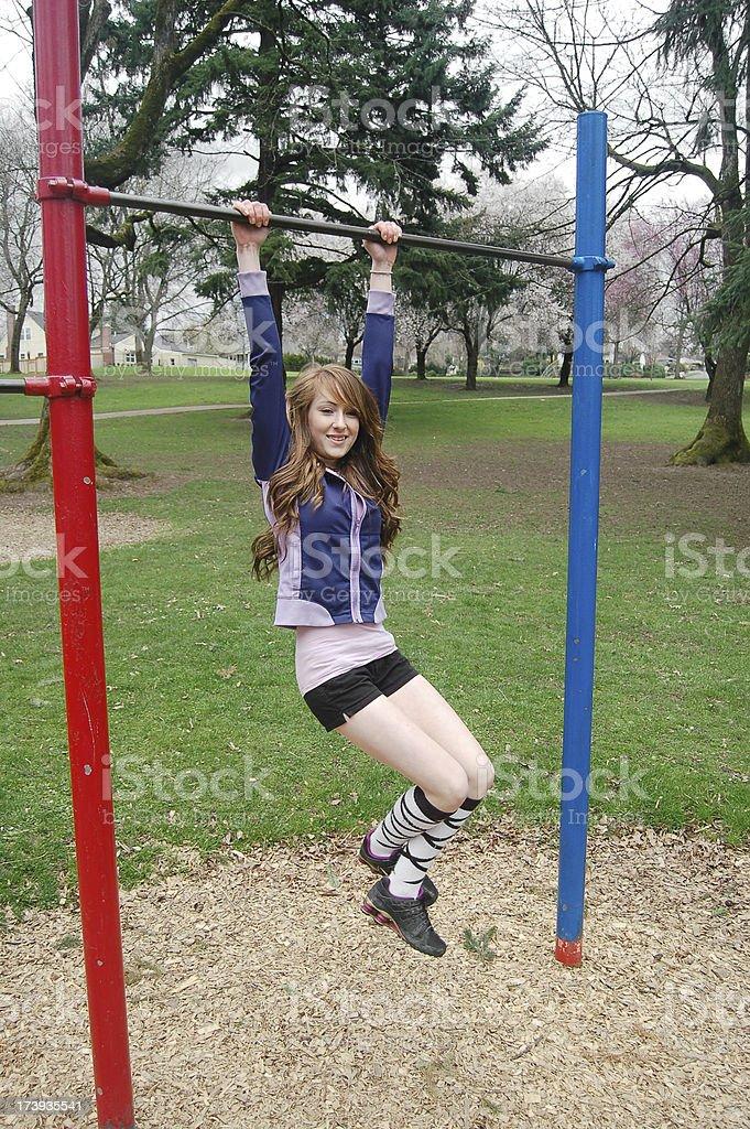 Girl Swings On Monkey Bars royalty-free stock photo