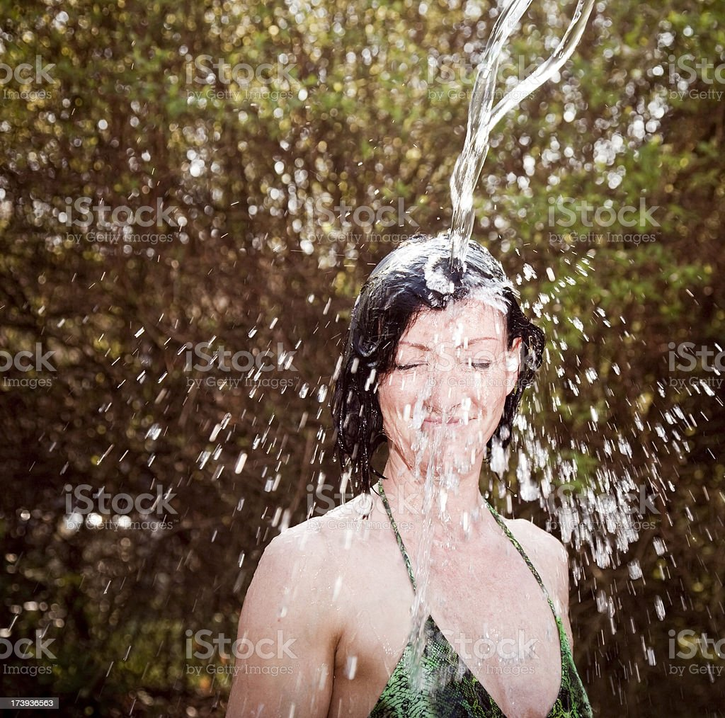 girl takes a shower in the garden royalty-free stock photo
