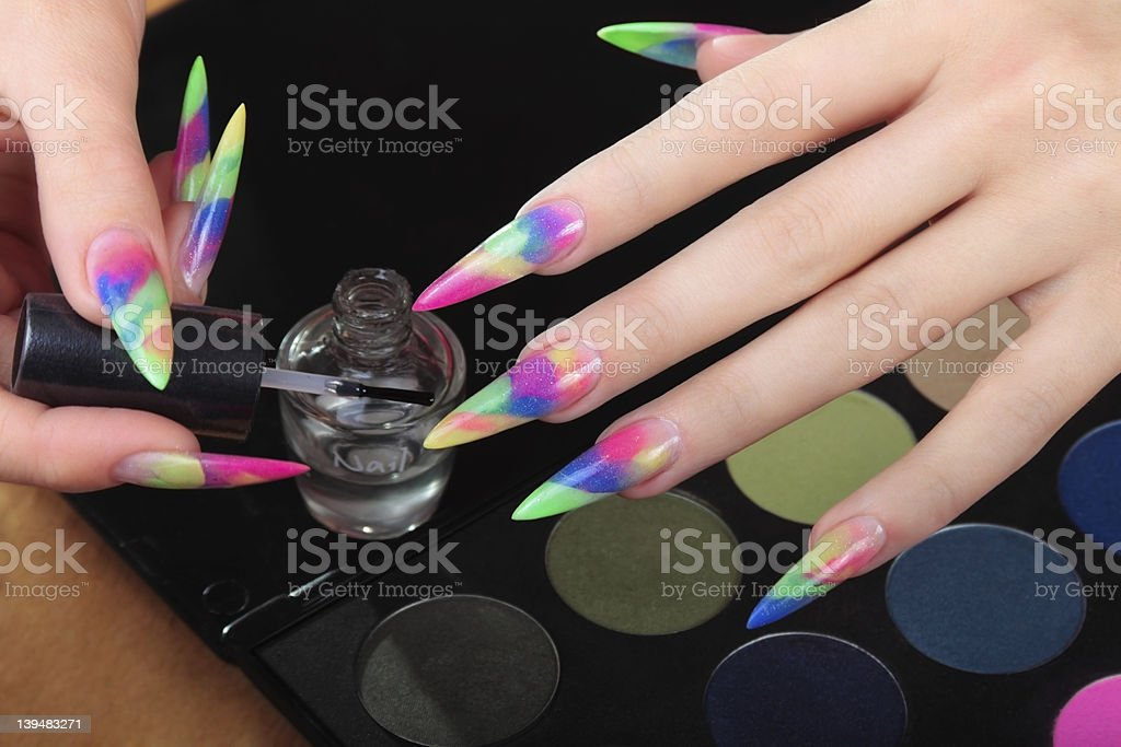 Girl takes care of the nails royalty-free stock photo