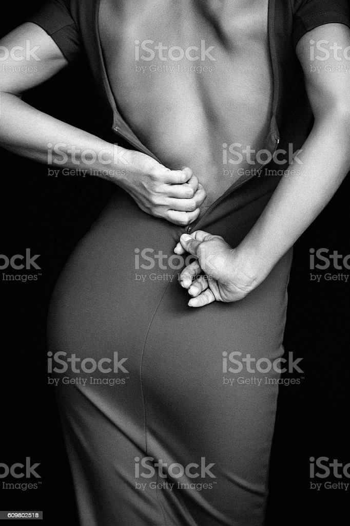 Girl takes off her dress stock photo