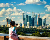 Girl takes photos of landmarks, buildings of Moscow city