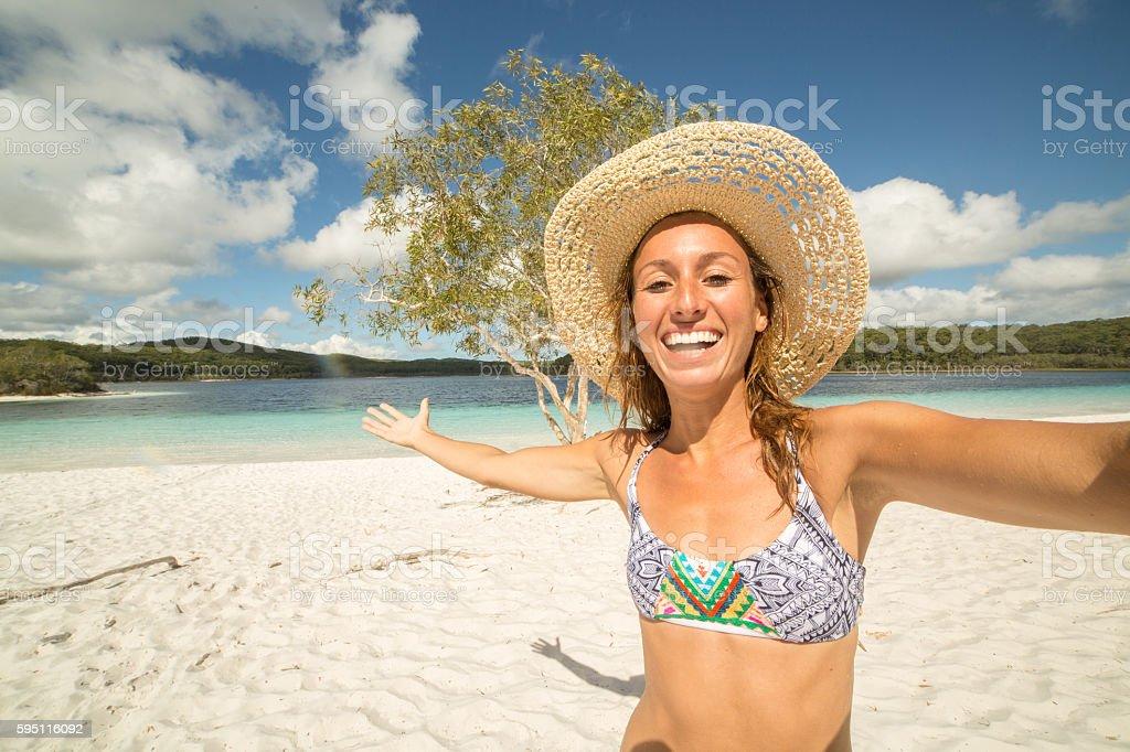 Girl takes selfie at lake McKenzie's beach stock photo