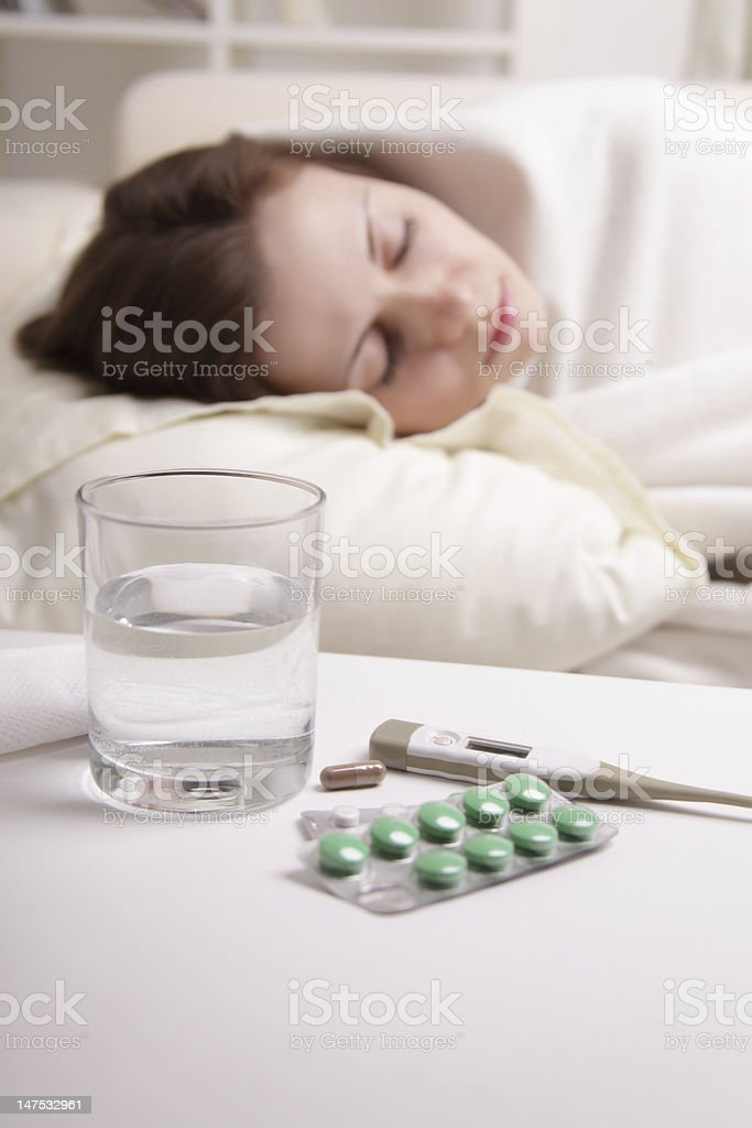 girl takes the pill royalty-free stock photo