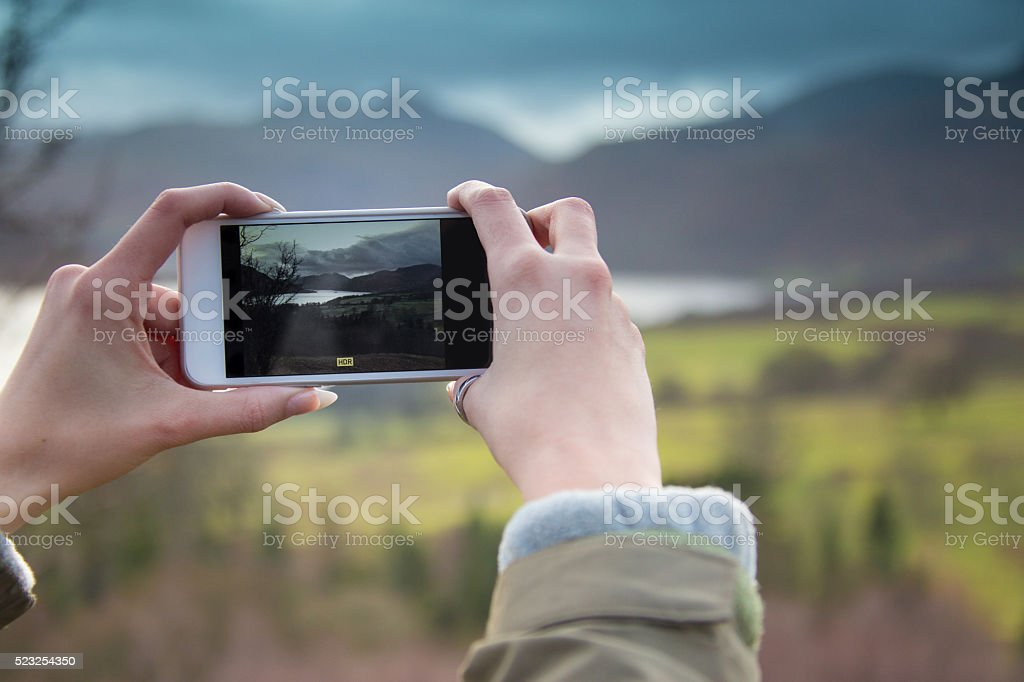 Girl Taking a Photo of Landscapes stock photo