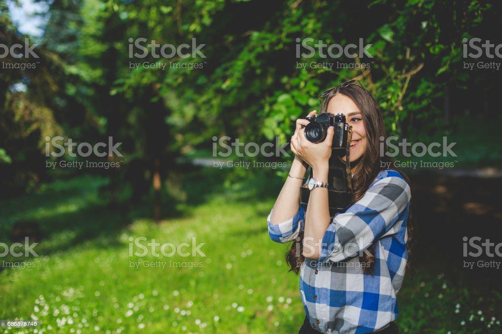 Girl taking a photo stock photo