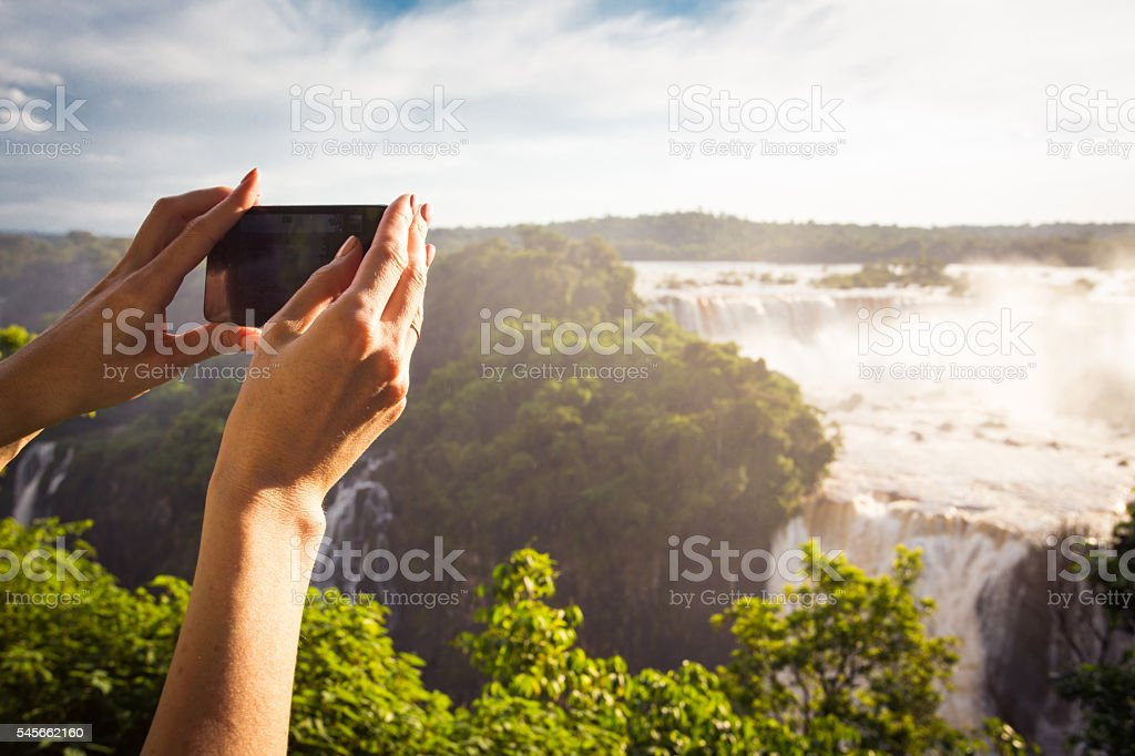 girl taking a photo with smartphone stock photo