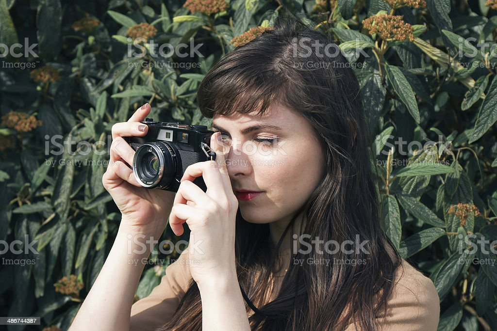 Girl Taking A Picture stock photo