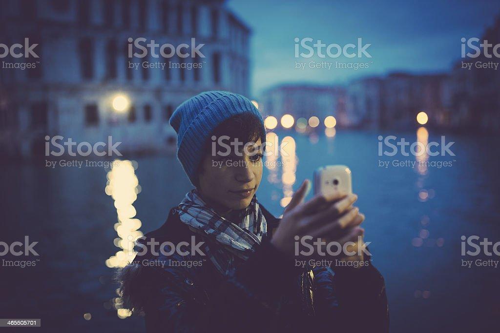 Girl taking photo in Venice royalty-free stock photo