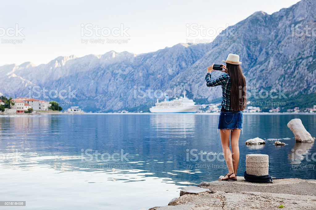 girl taking photo of cruise liner stock photo