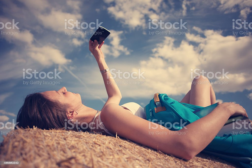 Girl taking photo with mobile stock photo